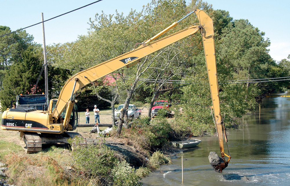 Workers dredge the Assawoman Canal in 2006. DNREC is conducting a study to prioritize future dredging projects, and is looking for the public's help.