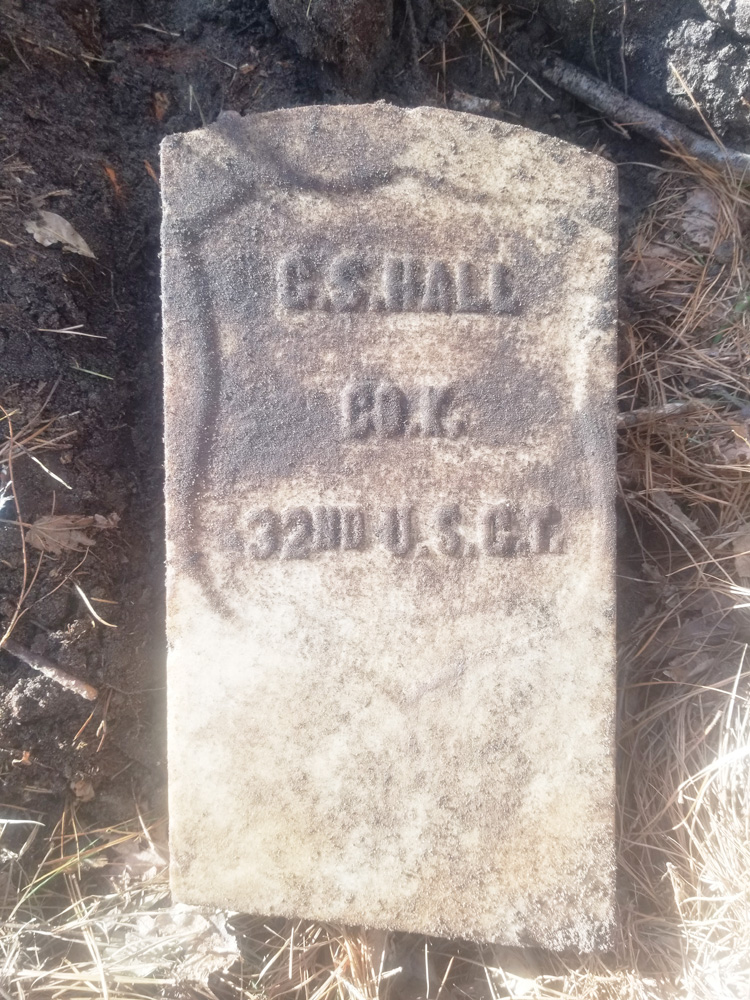 A headstone found at the site. bears the name C.S. Hall and the lines 'Co. K, 32nd U.S.C.T.,' an abbreviation for U.S. Colored Troops, the designation for units comprising African-American soldiers during the Civil War.