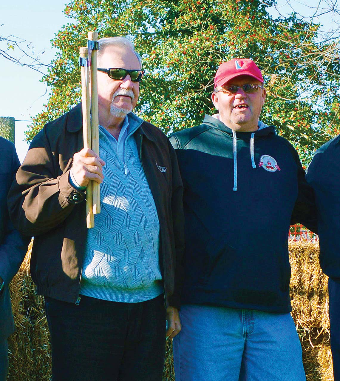 Politicians literally bury the hatchet, top, for all to see during this year's Return Day celebration on The Circle in Georgetown on Thursday, Nov. 8.