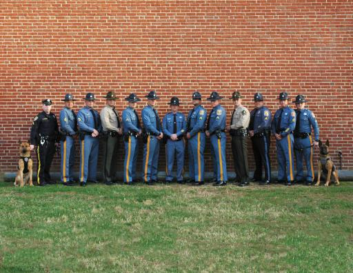 The graduates from the Delaware State Police Canine Training Unit pose for a photo after graduating from the 2018 Fall Patrol Certification and the Fall Narcotics Certification classes.