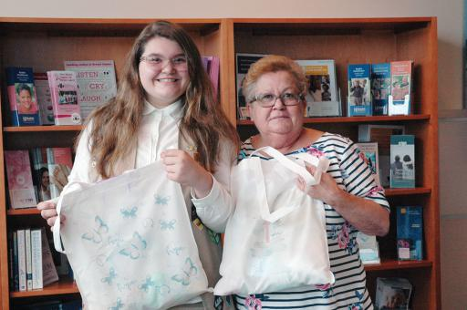 Mickayla Austin, left, appears with her grandmother MaryAnn Matyjewicz, right, a breast-cancer survivor who also served as Austin's mentor for her Girl Scout Silver Award project.