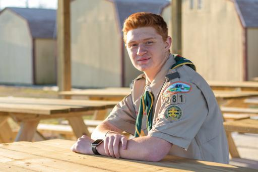 Eagle Scout candidate Aiden Christopher sits under the pavilion he built for the Hope Center.