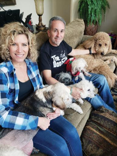 Theresa and Al Casapulla, who worked to get a bill passed so no more dogs die from  being over-vaccinated, cuddle their five dogs, from left, Wheeler, Henry, George, Buddy and Bentley.