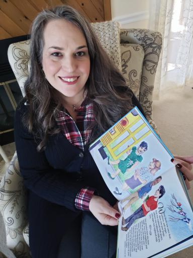 Local author Amy Burgard, in her Ocean View home, shows off her book 'Lift.'