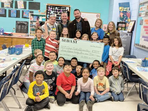 SEDAST presents Long Neck Elementary with their portion of the $3,145 donation from the Art in the Hat Raffle.