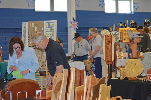 Attendees at a previous year's Artisans Fair shop for works of art from Delaware and surrounding states.