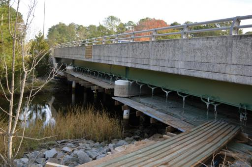 The next leg of the Assawoman Canal Trail is to build an 'underpass' of Route 26 on the canal's west side. The scaffolding will be removed after the conclusion of a bridge painting project.