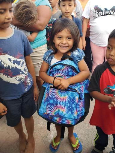 For these young asylum-seekers, happiness can be found in a new backpack.
