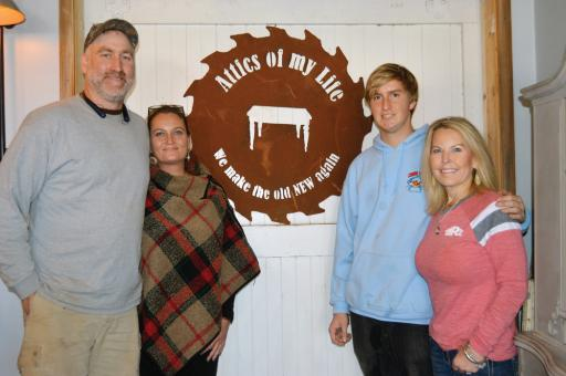 From left, owners Brad Sonczewski and Ashley Abell, Abell's son, Gage Abell and her sister, Bethany Drew, pause during the grand opening at Attics of My Life in Selbyville on Saturday, Oct. 13.