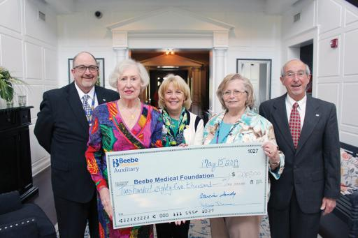 Beebe Healthcare and Beebe Auxiliary representatives gather during the annual luncheon, at which the group donated $285,000 to Beebe. Pictured, from left, are: Rick Schaffner, RN, interim CEO, executive vice president and COO of Beebe Healthcare; Auxiliary Treasurer Patricia Sandy; Judy Aliquo, CFRE, president and CEO of Beebe Medical Foundation; Lesley Nance, Auxiliary president; and Dave Herbert, Beebe Board of Directors chair.