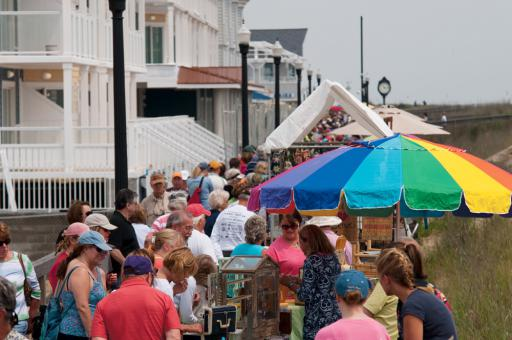 Scenes from a previous Seaside Craft Show give us a peak at vendors lining the boardwalk while patrons peruse their wares