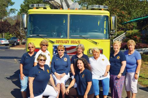 Members of the Bethany Beach Volunteer Fire Company's Ladies Auxiliary took a moment out of their time during the event to pose in front of a Quint 50 truck that was on hand for the tournament that was benefitting the fire company. Members include (in not particular order for the picture) Barbara Brown, Brandy Davis, Joy Knox, Marty Pratt, Mary Putschky, Sandy Raymond, Pat Resnick, Tricia Roberts, and Linda Smith.