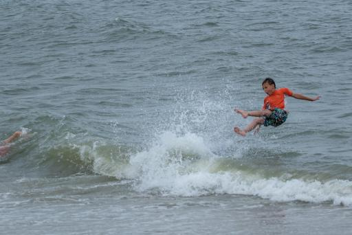A skimmer makes a splash after catching a wave during the Bethany Beach Skim Jam on Monday, June 24.