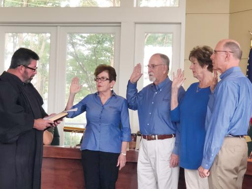 Bethany Beach Alderman Charlie McMullen, left, swears in (from left) Rosemary Hardiman, Lew Killmer, Faith Denault and Bruce Frye to two-year terms on Bethany Beach Town Council.