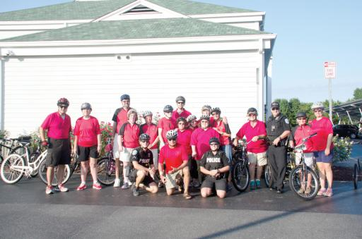 Members of the Sussex Riptide team pose with officers from the Ocean View Police Department at a pre-competition bicycle regatta at police headquarters last week.