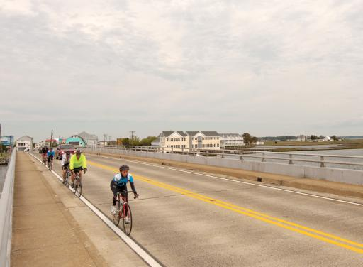 Bicyclists cross the Little Assawoman causeway in Fenwick Island back in 2013.
