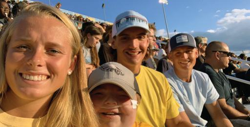 Kaylee Hall, T.J. Moore and Grant Argo pose for a photo with Beau Smith during the Blue-Gold game.