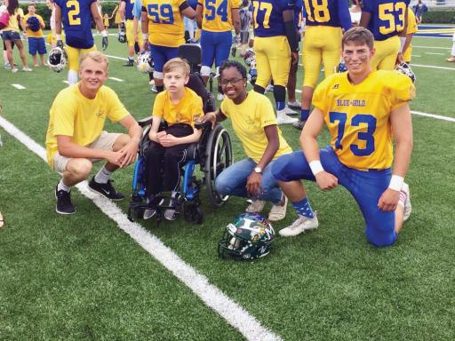 Participants from 2018's DRFC Blue-Gold game stop for a picture on the field. This year, IR's Zach Schultz will be joining their number to represent the Indians.