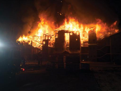 Firefighters from five companies came together to contain a blaze in an unnocupied apartment building in Millsboro. More than $1.5 million in property damage was reported.