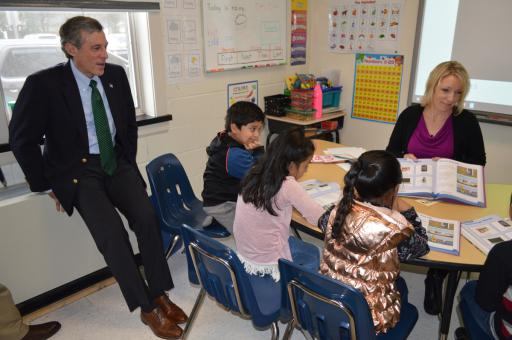 Gov. John Carney observes as Joan Glasgow's English-learning students learn the words for technology in the home, such as cell phone, computer and (sometimes) robots.