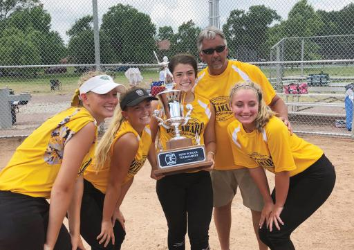 From left, Abby O'Shields, Taylor Wroten, Zoe Wilcox, Coach Jay Davis and Ashlyn Stonebreaker celebrate with the 2018 Carpenter Cup High School Softball Showcase championship trophy following the 6-5 win over Berks Lancaster Lebanon last week.