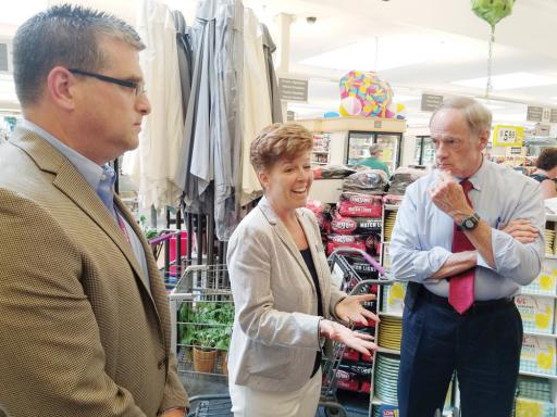 U.S. Sen. Tom Carper, right, discusses drug affordability in Millville with Kelly Shanahan and Paul Zvaleny of the Giant grocery and pharmacy company.
