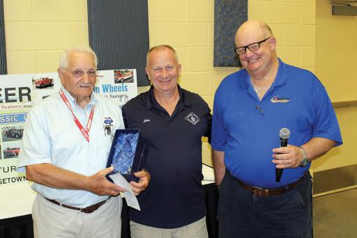 Crowned Best in Show at CHEER's 8th Annual Car, Bike & Truck Show was a 1947 Ford Coupe owned by John Scheetz of Milford. Shown at the presentation of the trophy are, from left: Show Co-Chairman Walter Koopman, Sheetz and CHEER Chief Executive Officer Ken Bock.