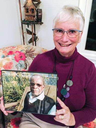 Christina Weaver, a freelance writer for the Coastal Point, is among the winners of the Rehoboth Reads writer's contest this year. Here she is pictured with a photo of her late husband, Ike, who is featured in her winning essay.