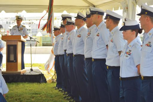 Sector Capt. Scott Anderson offers some insight to the local crew during the change-of-command ceremony at the Coast Guard Auxiliary last week.