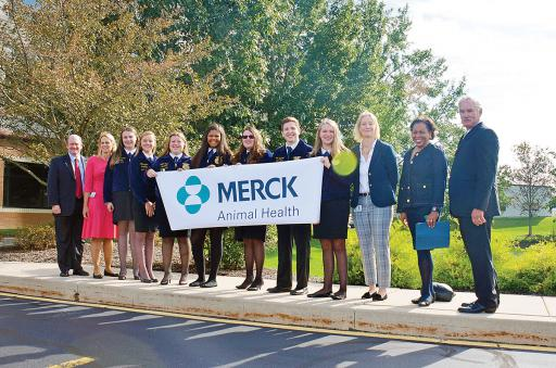 While touring the Merck Animal Health facilities in Millsboro, Millsboro Middle School students met several officials with an interest in agriculture, including U.S. Sen. Chris Coons, far left, and USDA Under-Secretary Michael Scuse, far right.