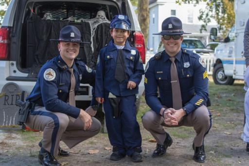 Jayden Wilkerson shows off of his costume, flanked by Bethany Beach Police Department officers Kenny Haynes, left, and Patrick Foley, right, at a previous Cops & Goblins.