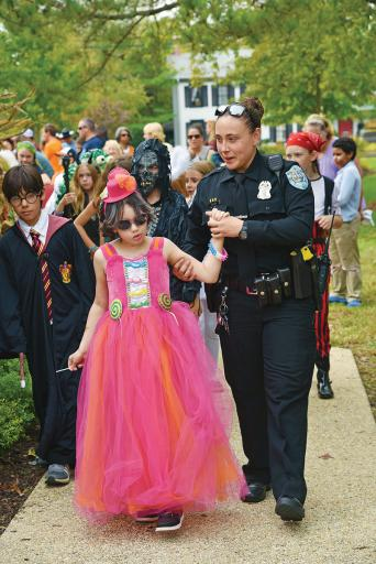 Participants in last year's Cops & Goblins costume contest show off their hard work.