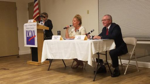 From left, Paulette Rappa and Doug Hudson speak to voters during a forum hosted by the League of Women Voters of Sussex County in Rehoboth Beach on Tuesday, Oct. 9
