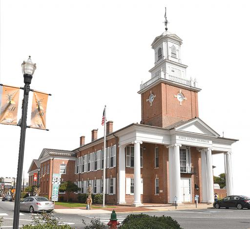 Sussex County Courthouse has served justice on The Circle since it was completed in 1839, with portico and cupola added in 1914.