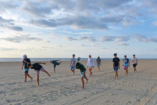 The Indian River High School boys' cross-country team trains on the beach in Bethany Beach. The boys hope to improve over last year.