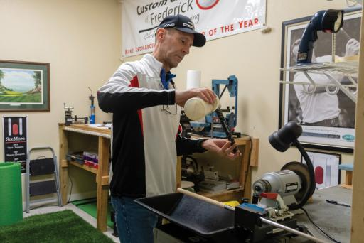 Michael Bednarcik prepares a grip for a club at his shop in Millville.
