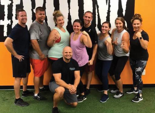 CustomFit 360's Eric Schreiber poses for a photo with some of his clients.