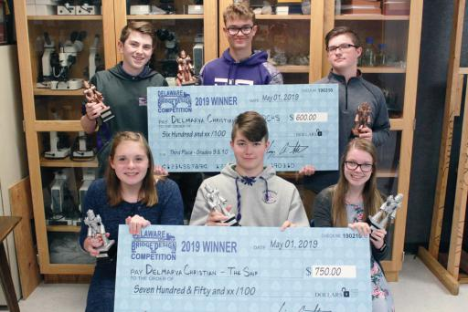 DelDOT Delaware Bridge Design Competition third-place award winners include, back row, DCHS freshmen Noah Culver, Aaron Brown and Michael Hart, and second-place award winners, front row, Isabelle Donihue, Gavin Catron and SarahAnne Smith.