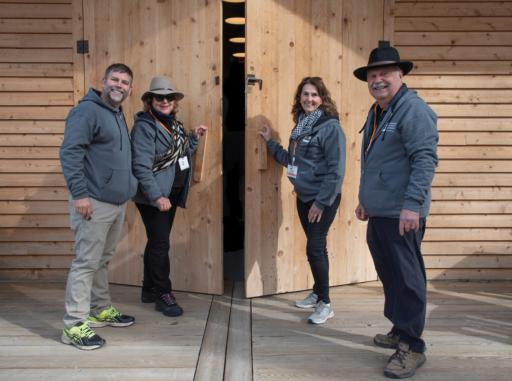 From left, Deputy Executive Director and Director of Horticulture Brian Trader, Executive Director Sheryl Swed, Vice President Carol McCloud and President Ray Sander close the DBG gates for the 2019 grand-opening season.