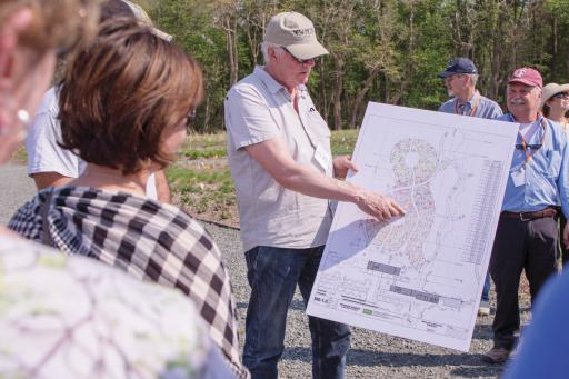The Delaware Botanical Gardens held a 'Sip & Saunter' event on Friday, May 4. Right, DBG designer Piet Oudolf goes over the garden's plans during the event.