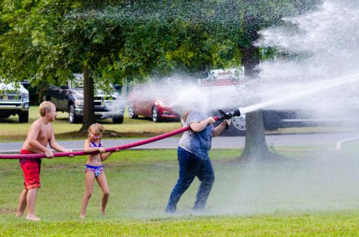 Camp participants have some fun with a firehose battle at the Delaware Burn Camp at Camp Barnes last week.