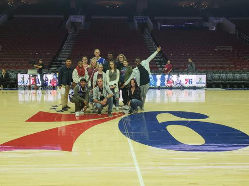 Attending the 76ers event were, from left: back row, Edward Deleon, Lauren Moon, Brayden Ostan, Tristin West, John Krytsis, Educational Lab Specialist Chelsea Wootten, Lester Fair, Jana Ruark, Carson Williamson, Kylie Brown and Howard Mumford; front row, Safi Furlow, Department Chair Rob Rector and instructor Jessica Farley.