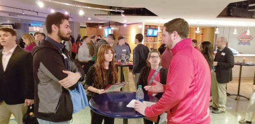 DTCC communications students, from left, Chris Parker, Madison Griffin and Cassidy Clark get career advice from Phillies Social Media Representative Tim Stoeckle during the College Winter Summit at the Wells Fargo Center.