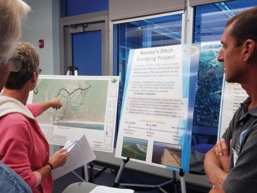 Deb Barber, left, asks DNREC's Michael Powell about the Massey's Ditch dredging project.