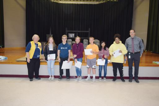 Six Selbyville Middle School students won prizes from the Lord Baltimore Lions Club in the group's drug-free poster contest, designed to encourage youth to avoid illegal and non-prescribed drugs. Pictured celebrating the honor, from left, are: LBLC President Janet Bauer, winning SMS students Samantha Ciociola, Isaac Smith, Taylor Conaway, Collin King, Gina Garcia and Shanyla Hanley, and SMS Principal Jason Macrides.