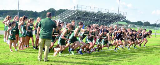Indian River High School's cross-country team takes off at the start of their home opener.