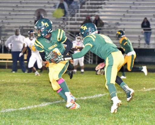 QB Jalen Snead, above, hands the ball off to RB Kevin Custis during IR's 32-20 loss to Seaford during Homecoming week.