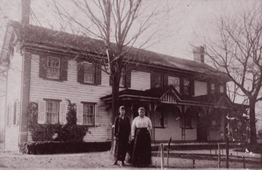Mrs. Ethel Tunnell, left, and Anna R. Dukes stand before the Dukes house.