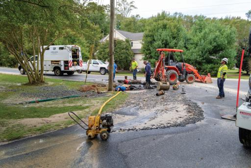 Road crews work on the damage from a truck striking a fire hydrant in Ocean View on Tuesday, Oct. 16.