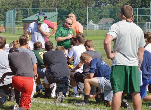 Todd Fuhrmann talks to the football team about safety during practice on Wednesday, Aug. 15.